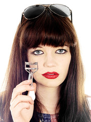 Young Woman Using Eyelash Curler. Model Released