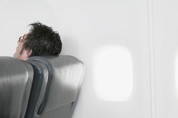Man resting on airplane