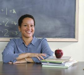 Teacher sitting at her desk