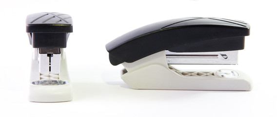 Composition of two identical office staplers