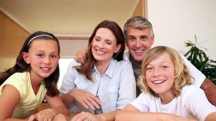 Happy family waving at the camera