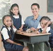 Young school girls with teacher