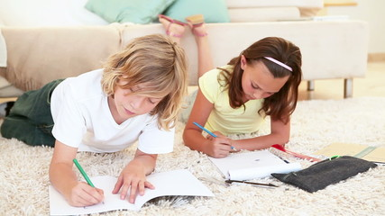 Siblings coloring together