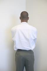 Businessman facing wall