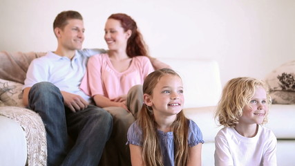 Peaceful family watching the television