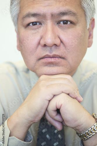 Businessman posing intently