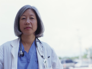 Mature female doctor posing