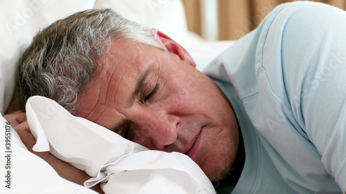 Mature man waking up