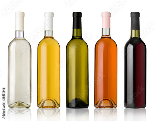 Foto op Plexiglas Bar Set of white, rose, and red wine bottles.