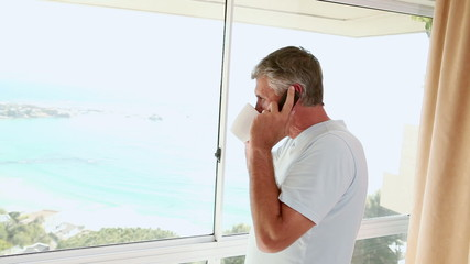 Mature man talking on the phone