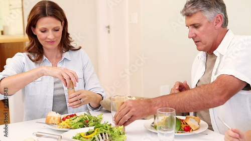Family seasoning their meal