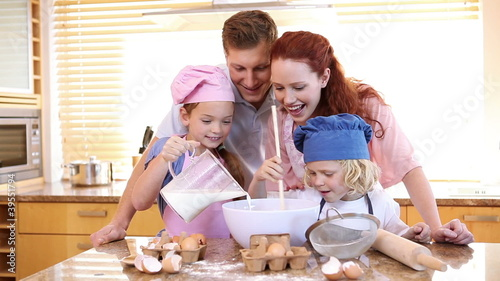 Family making a cake