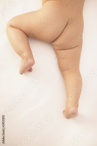 Naked baby's bottom and legs