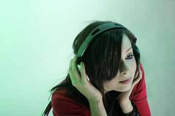 A pretty girl listening to music