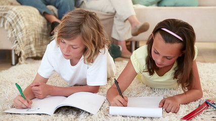 Siblings doing their homework