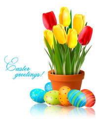 Fresh spring flowers with Easter eggs