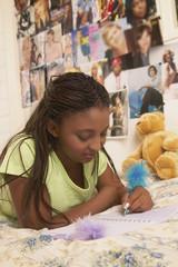 Teenage girl writing in journal
