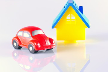 small red toy beetle car and house