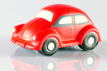 small red toy beetle car