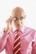 Businessman adjusting glasses