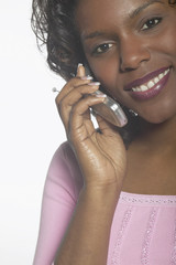 Close up portrait of woman talking on cell phone
