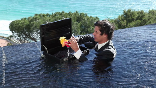 A businessman in a pool