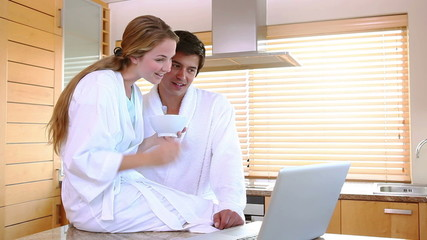 Couple in bathrobes on a video chat