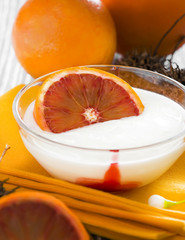 A cup of yogurt with citrus fruits from Sicily