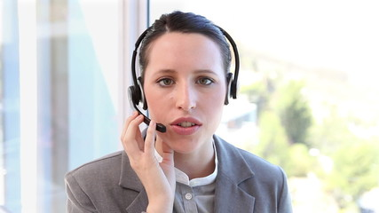 A woman speaking in a headset