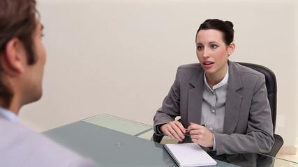 A woman interviewing a man