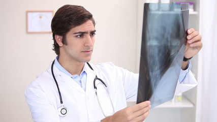 A doctor examining an x-ray scan