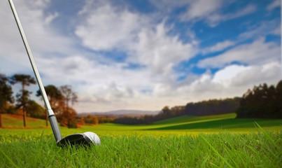 hitting golf ball on fairway