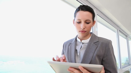 A businesswoman using a tablet