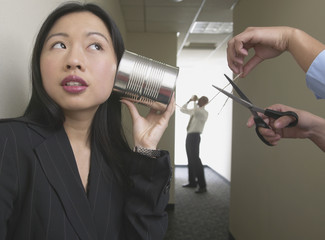Business people talking with tin can on string