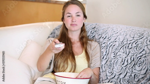A woman eating popcorn