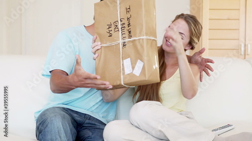A couple receiving a package