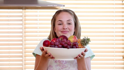 Housewife smelling a fruit bowl
