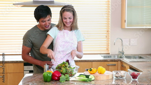 A woman mixing a salad