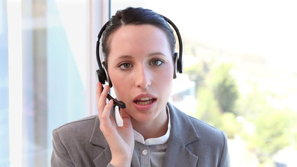 Woman with a headset is speaking