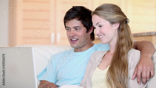 Couple watching a video on a laptop