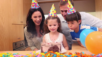 Girl celebrating her birthday with her family