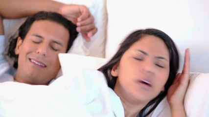 Woman can not sleep because of her snoring husband