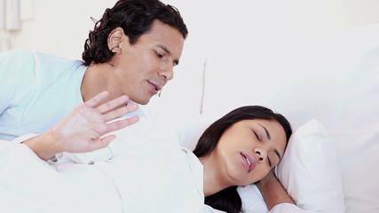 Woman rejecting husband's advances
