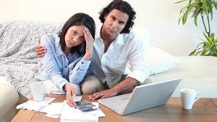 Man reassuring his wife about bills