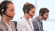 Call centre agents working with headsets