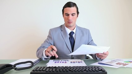 Businessman working on charts