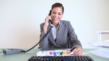 Businesswoman calling while working