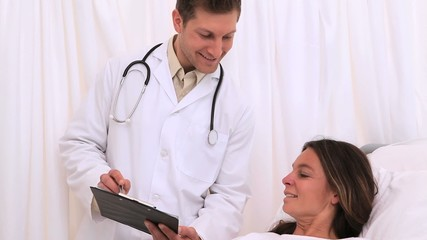Doctor showing his clipboard to his patient