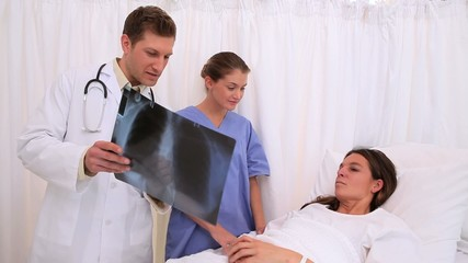 Doctors explaining an x-ray to a patient