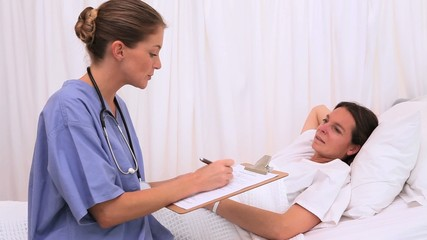 Patient listening to her nurse